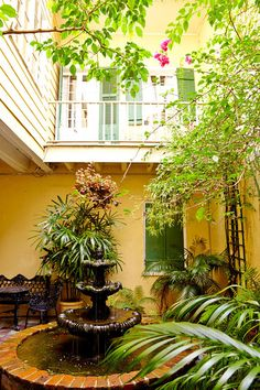 The courtyard of the circa-1820 Creole mansion that houses Fisher's duplex is accessed via a street-level passageway once used for horse-drawn carriages.