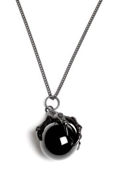 RAVEN CLAW. Large All-Black Claw around a genuine Obsidian Crystal Ball. OBSIDIAN is truth-enhancing. A strongly protective stone, it forms a shield against neg