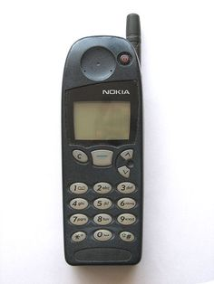 Nokia 5160. My husband bought this phone for us to share in 2000. I loved the interchangeable faceplates and Snake! We even bought a new circuit board to change the led lights from green to blue. Ah, memories!