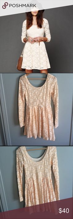 Free People Rose Garden Fit-and-Flare Dress This pale peach long-sleeved dress is made of stretchy lace in a floral pattern. Fitted waist, lightly pleated skirt, rounded neckline. Worn minimally. The inside size tag has been removed but the metal Free People tag remains (see picture). One small spot under one arm where fabric appears a bit stretched (see picture). Free People Dresses Long Sleeve