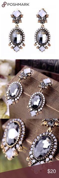 "Austrian Crystal and Rhinestone Dangle Earrings NEW!! Stunning!! Austrian Crystal and Rhinestone Dangle Earrings!! Length: 2"" Width: 3/4""   Materials: Crystal/Acrylic/Nickle-Free Alloy Jewelry Earrings"