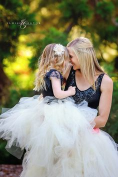 Matching mother and daughter outfits. Soft apricot tutus with black lace tops.