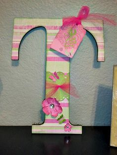 Altered decorated letter covered in scrapbook paper craft