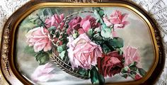 This outstanding antique c1910 barbola frame showcases a basket tipped to overflowing with cabbage roses and rosebuds. The study is taken from a painting in our personal collection, modeled after the work of Victorian artist Catherine Klein. The print is a reproduction, with soft