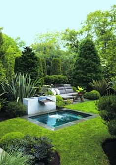 Tucked behind an inviting plunge pool and fountain, the garden's patio features furniture from Design Within Reach. Landscape designer Joseph Cornetta