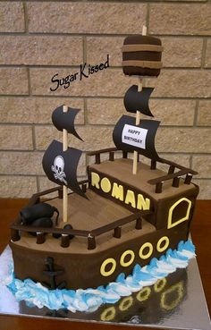 A pirate ship cake created by Shandi Sansom from Sugar Kissed. All edible except for the two poles with black flags. Please visit my Facebook page to see more of my work: www.facebook.com/sugarkissedshandi