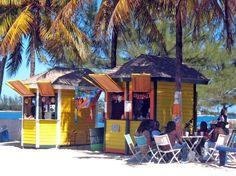Colorful huts under tropical palms - Bahamas Nassau