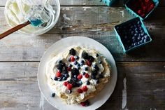 nutty, crispy and chewy almond butter meringues topped with fresh whipped cream and berries