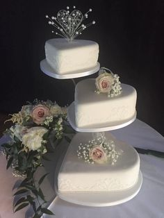 Heart shaped wedding cakes on three tier cake stand decorated with fresh flowers. H. S. Cake Design, wedding cakes, Gloucestershire .