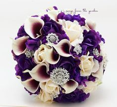 This lush and lovely bouquet in shades of purple, plum and ivory can be yours to have and to hold on your wedding day! I can create it for you as shown or customize it to fit your color scheme. We can