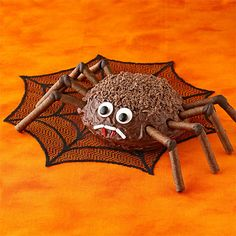 "Chocolate Spider Cake    Spiders usually make people say ""eek!"" But this concoction of luscious cake, sweet chocolate and delicious candy will make family and friends say ""yum!""        See Scary Spider Cake Recipe."