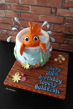 Pretty Goldfish - cake by Nix Kitchen