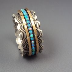 Opal spinner ring- find it at:  StoneAddict.etsy.com
