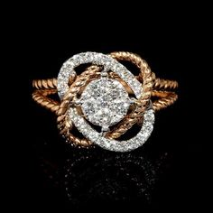 Diamond knot ring featuring 33 round brilliants .48ctw set in 18k white and rose gold.