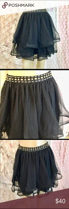 My Michelle poof skirt Waist line is embellished with beads. 100 percent polyester both inner and outer shell. Hangs 18 in down My Michelle Skirts