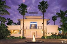 """Architect Robert M. Swedroe renovated the house he shares with his wife, Rita, on Biscaya Island, in Florida. A limestone drive wraps around the fountain at the entrance. A steel door with portholes and two new rooftop terraces """"give the house an elegant appearance,"""" says Swedroe."""