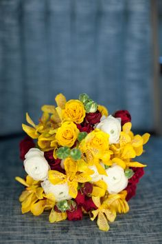 Wedding bouquet- yellow alstroemeria, red roses, and white ranunculas -bridesmaids bouquet -nosegay bouquet style