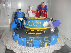 Ace Batman Krypto Superman Cake: Ok - I admit I had never heard of either of these characters ACE & Krypto when I was first asked to make this cake. BUT, I found a cheap superman and batman
