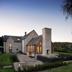 FARMHOUSE – a modern farmhouse at dusk, farmhouse style is so appealing, even recently built homes copy the floorplans and style.