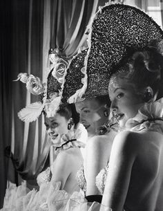 1947: Showgirls in costume wearing ornate hats at the Latin Quarter nightclub, in NYC. Photograph by Gjon Mili.