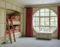 Built-in bunk beds and circular window.