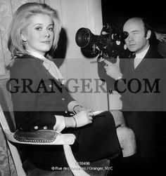 This is a Granger licensable image titled 'RAPPENEAU AND DENEUVE. french director Jean Paul Rappeneau receiving movie prize for his film A Matter of-Resistance january 15, 1966 here pretending to film his actress Catherine Deneuve. Full credit: AGIP - Rue des Archives / Granger, NYC -- All Rights Reserved. ' by GRANGER All rights reserved. You may not copy, publish, or use this image except for sample layout ('comp') use only. You must purchase the image from Granger in ...