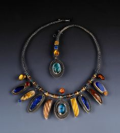 Jeanie Pratt--Exotic Origins; includes butterfly wings, beetle wings and amber with insect inclusions..