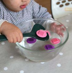 Spoon fishing to work concentration, eye-hand coordination and fine motor skills. Montessori Baby, Montessori Education, Montessori Activities, Infant Activities, Activities For Kids, Practical Life, Toddler Learning, Baby Games, Baby Play