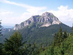 """Veľký Rozsutec (1610 m.n.m.) I climbed this majestic mountain with my boyfriend during  3-day hike across Krivánska Malá Fatra ridge in 2013. We saw this peak from almost every point during our yourney. We enjoyed also the way down to """"Sedlo Medziholie"""" which is secured with chains. This hike was really exhausting but definitely worth it."""