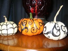 Halloween Pumpkin-Decorating Project by The Lonely Sock    I did this a few years back with miniature pumpkins and black Sharpies.  I have a couple more pictures of them at different angles on my blog.  I'm really happy with how these turned out.    This project might be a great idea for someone who isn't up to carrying a heavey pumpin, carving a traditional Jack O'Lantern, or cleaning up the mess after.