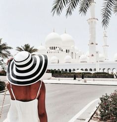 Travel in style, ALWAYS. This hat is so cute and stylish matching that cute white tank!