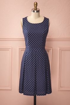 Polkadots have never been as charming as in this classical navy pleated dress.