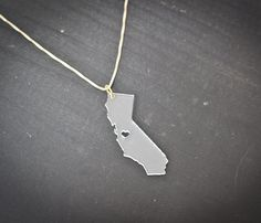 State necklaces. This site has a bunch of different options. Pretty cool!