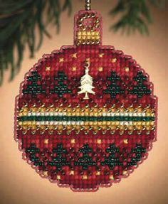 """This complete counted glass bead kit with charm is part of the 2011 Mill Hill Christmas Jewels Ornament collection.   The kit includes Mill Hill Glass beads, Mill Hill Charm, 14-count perforated paper, floss, needles, and chart with instructions.   Design size is 2.25"""" x 2.75""""."""