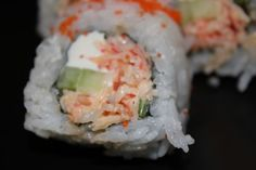American Sushi Roll Recipe — Spicy Crab with Cucumber and Cream Cheese - I could do this as a lettuce wrap to lower the calories for a light lunch or snack!
