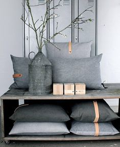 grey pillows with leather trim