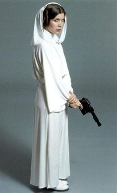 Princess Leia (Carrie Fischer) in Star Wars IV with a variant of the DL 44 blaster. Star Wars Pictures, Star Wars Images, Star Wars Film, Star Wars Poster, Natalie Portman, Leila Star Wars, Carrie Frances Fisher, Leia Costume, Star Wars Princess Leia