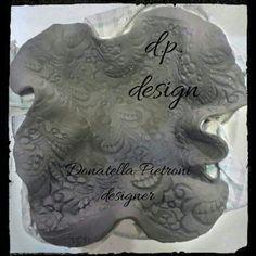 Piatto in terracotta crudo - d.p. design di Donatella Pietroni designer