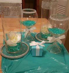 DIY Tiffany & CO. wedding centerpieces I added the bling around the edges and glued the candle holder stand to the candle holder and purchased crystal glass gems ! if you\'re looking for authentic fragrances . Tiffany Blue Party, Tiffany Theme, Tiffany Wedding, Tiffany And Co, Tiffany Co Party Ideas, Tiffany Blue Weddings, Green Weddings, Tiffany Blue Centerpieces, Diy Centerpieces