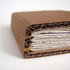 A handmade cardboard bound book by robayre, using yellow binding thread. Handmade Journals, Handmade Books, Handmade Notebook, Cardboard Crafts, Paper Crafts, Bound Book, Kirigami, Book Binding, Book Journal
