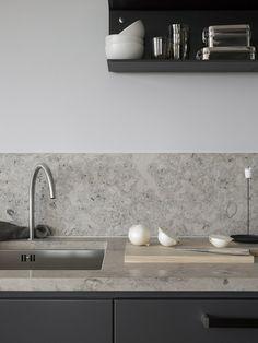 Dark grey kitchen with a natural stone top - via Coco Lapine Design blog