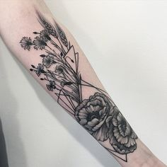 Flower with plants sleeve tattoo - This sleeve tattoo could work with both men and women. The meanings could differ depending on the flower that you choose for your design. There are symbols for love, wealth, gentleness and purity among others.