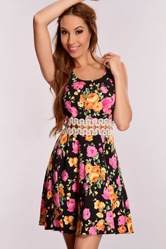 Spend the season in style with this super cute dress! Everyone will have all eyes on you. It features a scoop neck, floral printed all throughout, sleeveless, crochet mid section cut out and pleaded waist skirt. 70% Polyester 25% Rayon 5% Spandex