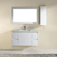 The Bauhaus Bath Bamos 42 in. Single Bathroom Vanity Set with Mirror and Wall Cabinet gets its boldness from a floating installation that brings contemporary flair to its classic shape. European inspiration brings standout style to your bathroom. Sloped Ceiling Bathroom, Single Sink Bathroom Vanity, Bathroom Vanities, Vanity Set With Mirror, Bathroom Essentials, Vanity Cabinet, Bathroom Furniture, High Gloss, Home
