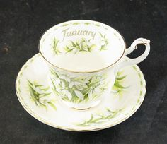The Rare Bird is Pleased to Offer this Fine Bone China Cup and Saucer made by Royal Albert This Set from the Flower of the Month and is Snowdrops for the Month of January This Set is in excellent condition with No Damage. No Chips and No Cracks Gold Trim is in very good condition.