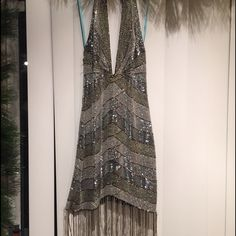 Hand-beaded Dress Hand-beaded with silver tones. Simply stunning!! Halter dress with open back. Missing beads around the zipper and a little by the neck but you can buy these beads and sew them back on!! It will be worth the work! Marciano Dresses Mini