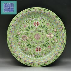 "A Rare And Massive Chinese Famille Rose Plate On JiChi Wood Stand: finely painted with lotus blossoms amid scrolling foliages, all reserved on turquoise glazed ground, presented on Jichi wood Stand, the six character reign mark of ""Jiaqing"" enamelled in blue on the base"