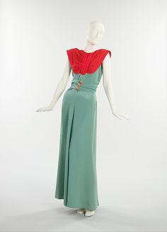 1940 Schiaparelli - awesome way to show off some prize buttons. And solid fabrics are easy to find!