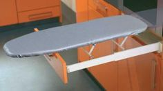 An excellent space saving solution in any kitchen or bedroom. The entire ironing board is built into the drawer space of most standard base cabinets and can be accessed by simply pulling the drawer open and unfolding the board. Kitchen Table With Storage, Kitchen Drawers, Kitchen Bins, Drawer Dividers, Drawer Fronts, Ironing Board Covers, Ironing Boards, Home Storage Solutions, Iron Board