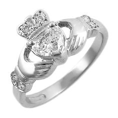Claddagh ring (heart for love, crown for loyalty, hands for friendship). Ever since I saw Leap Year I'v wanted one. This is so cool.